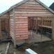 Oak Frame single garage with adjoiing log store