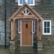 Oak porch with stone plinth