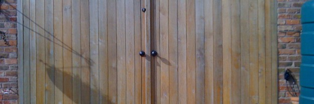 Oak garage doors treated with danish oil for a natuarl finish with UV filters